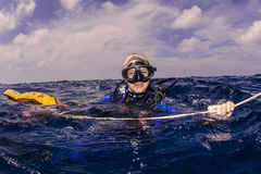 Female diver on the surface Stock Photography