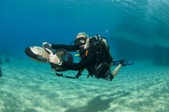 Female diver on underwater scooter