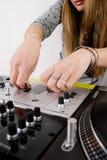 Female DJ adjusting sound level Royalty Free Stock Photo