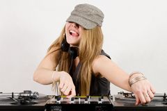Female DJ adjusting sound level and pitch Royalty Free Stock Photo