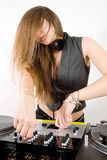 Female DJ adjusting sound levels Royalty Free Stock Photos