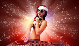 Female dj in christmas wear Royalty Free Stock Photo