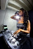 Female DJ with Computer Display Royalty Free Stock Photos