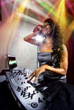 Female DJ with Computer Display Stock Images