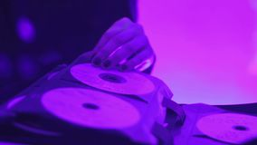 Female dj hand turning pages of music cd collection during performance in club. Stock footage stock footage