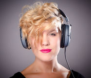 Female DJ with headphones Stock Photos