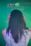 Female DJ listening music on headphone Royalty Free Stock Images