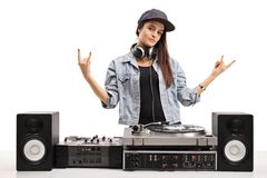 Female DJ making rock hand gestures. Isolated on white background Royalty Free Stock Photo