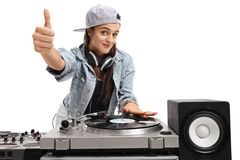 Female DJ making a thumb up sign. Isolated on white background Royalty Free Stock Photography
