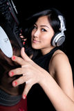 Female DJ mixing on turntables. A female DJ mixing on a pair of turntables Stock Image