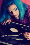 Female DJ playing music on vinyl records Royalty Free Stock Images
