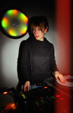 Female DJ playing music on vinyl records Royalty Free Stock Photo