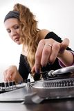 Female dj puts needle on vinyl record Royalty Free Stock Images