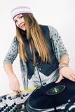 Female DJ scratching the record Stock Image