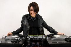 Female DJ at the turntables Royalty Free Stock Image