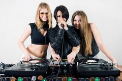 Female Djs and a singer. Three attractive young musicians playing vinyl and singing Stock Photos