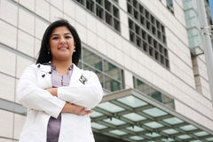 Female Doctor. Attractive female doctor standing outside with arms crossed Royalty Free Stock Image