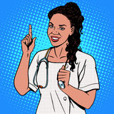 Female doctor of African. The adult doctor the therapist smiles. The profession of medicine and health pop art retro style stock illustration