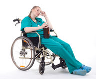 Female doctor with alcohol on wheelchair Stock Image