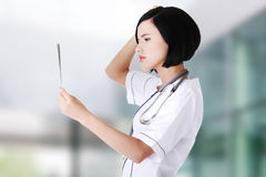 Female doctor analysing x-ray Stock Photos