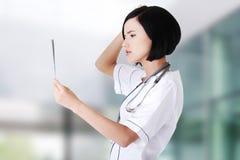 Female doctor analysing x-ray Stock Photos