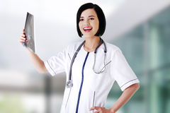 Female doctor analysing x-ray Stock Images