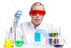 Female doctor analyzes some liquids Royalty Free Stock Photo