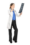 Female doctor analyzing an x-ray Royalty Free Stock Image