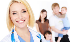 Female Doctor And Young Family With Two Children Stock Photos