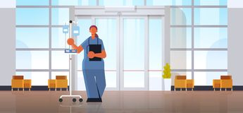 Female Doctor Anesthesiologist In Uniform Holding Dropper Medicine Healthcare Concept Modern Hospital Medical Clinic Royalty Free Stock Images