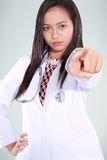 Female doctor angry and pointing Stock Photography