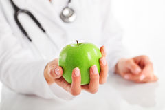Female doctor with apple. Female doctor with green apple Stock Photos