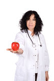 Female doctor with an apple. Royalty Free Stock Images