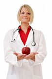 Female Doctor with Apple and Stethoscope Isolated Royalty Free Stock Images