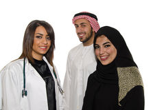 Female Doctor with Arab Couple Stock Image