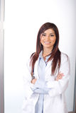 Female doctor arms crossed Royalty Free Stock Photos