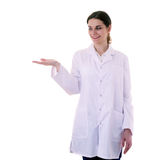 Female doctor assistant scientist in white coat over  isolated background. Smiling female doctor assistant scientist in white coat over white isolated background Royalty Free Stock Photos