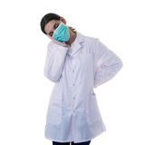 Female doctor assistant scientist in white coat over  isolated background Royalty Free Stock Image