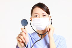 Female doctor auscultating with stethoscope Royalty Free Stock Image