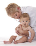 Female doctor and a baby Stock Photos
