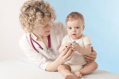 Female doctor and baby patient. Royalty Free Stock Photography