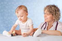 Female doctor and baby patient. Royalty Free Stock Image
