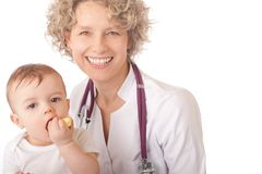 Female doctor and baby patient. Royalty Free Stock Images