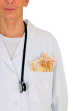 Female doctor with banknotes in the pocket Royalty Free Stock Photos