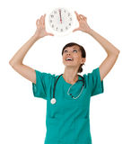 Female doctor with a big clock Royalty Free Stock Images
