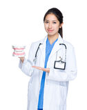 Female doctor with big jaw Royalty Free Stock Photography