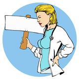 Female doctor with blank banner Royalty Free Stock Images