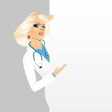 Female doctor with a blank presentation board Royalty Free Stock Photography