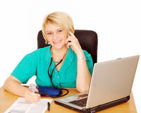 Female doctor with blood pressure devic Stock Photography