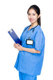 Female doctor with blue uniform Stock Photography